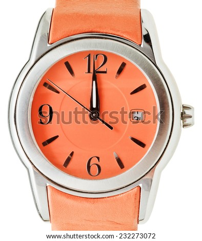 one minute to twelve o'clock on dial of orange wristwatch isolated on white background - stock photo