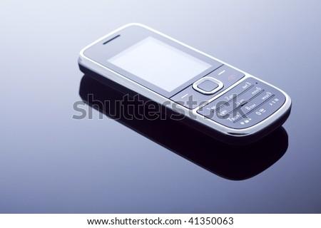 One modern elegant mobile phone - stock photo