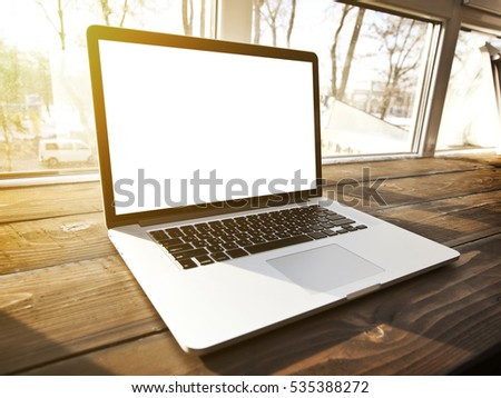 One modern laptop on hte window-sill