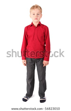 one nice boy wearing shirt and pants is standing. isolated.