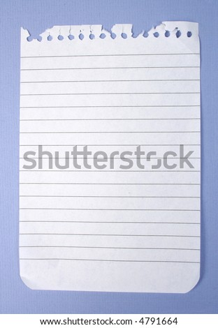 one notebook paper torn out - stock photo