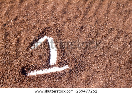 one number draw on cocoa powder, white background - stock photo