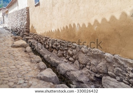 One of ancient alleys of Ollantaytambo village, Sacred Valley of Incas, Peru - stock photo