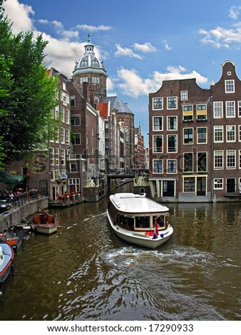 One of canals in Amsterdam, view on Church of St. Nicolaas - stock photo