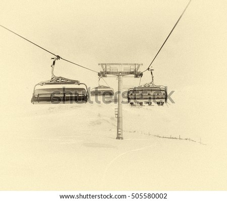 One of chair lifts in a ski resort of a valley of Zillertal in fog - Mayrhofen region, Austria (stylized retro)