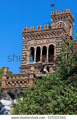 One of folly towers in the Trevelyan Gardens created in the 18th Century by Florence Trevelyan in Taormina, Sicily, Italy