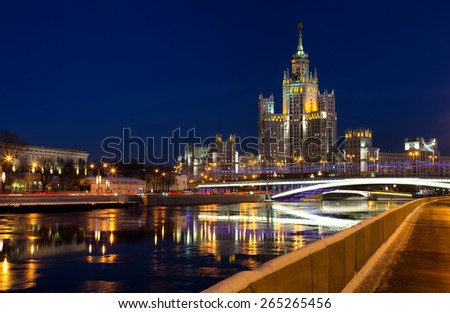 One of seven Stalin skyscrapers: the high-rise building on Kotelnicheskaya Embankment in night illumination, Moscow - stock photo