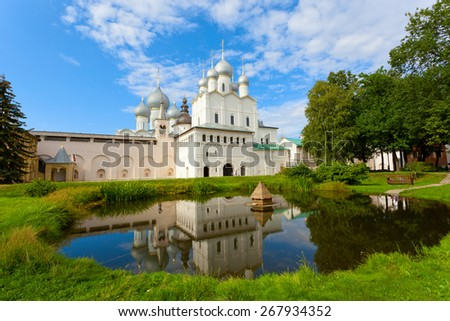 One of temples of the Rostov Kremlin is reflected in a pond - stock photo