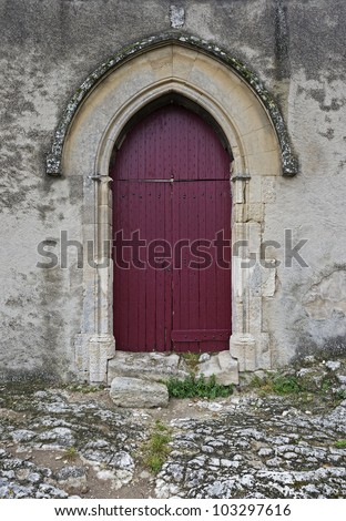 "One of the ancient doors of the monastery ""Montmajour"" in South France"
