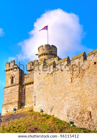 One of the corner turrets and ramparts of the Medieval Lincoln Castle, England - stock photo