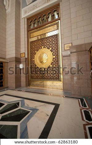 One of the doors made of brass at Masjid Nabawi in Medina, Saudi Arabia. - stock photo