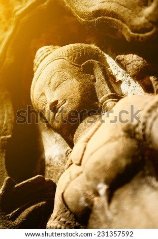One of the giant stone faces at Bayon Temple at Angkor Wat, Cambodia - stock photo