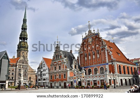 One of the greatest architecture in the Baltics, is the St. Peter's Church in Riga. Next to the church there is the House of the Blackheads. - stock photo