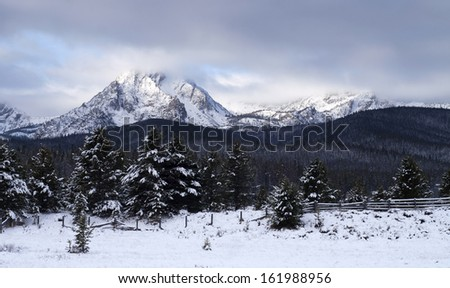 One of the high mountains of the Sawtooth Range National Recreation Area in winter near Sun Vally Idaho - stock photo