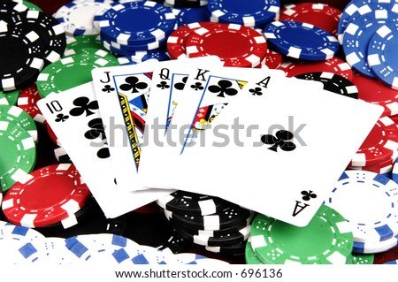 One of the highest hands in poker a Clubs Royal Flush on a bed of poker chips