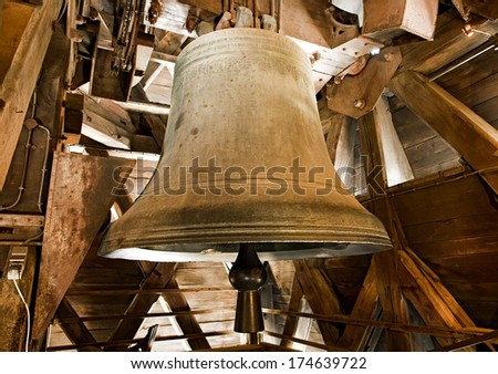 One of the large old bronze bells in the bell tower of the Notre Dame Cathedral in Paris. - stock photo