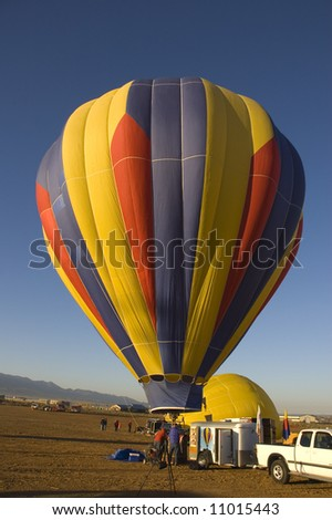 One of the many balloons at the Taos balloon festival being inflated at dawn