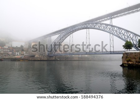 One of the many bridges of Porto, Portugal, in a foggy summer morning - stock photo