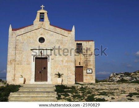 One of the many little medieval chapels in the countryside of Malta - stock photo