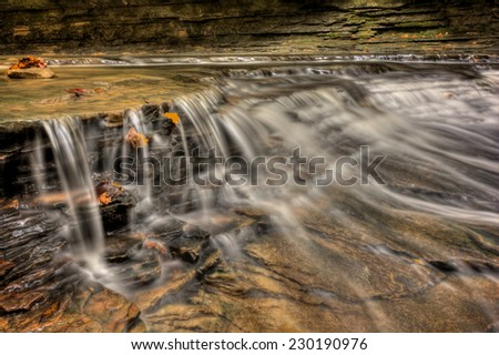 One of the many scenic waterfalls along the Sulpher Springs Creek in Ohio .  Located in the South Chagrin Reservation Cleveland Metroparks. - stock photo