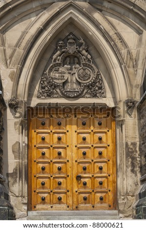 One of the many solid wood decorative entrance doors to the government buildings on Parliament Hill in Ottawa, Ontario, Canada. - stock photo
