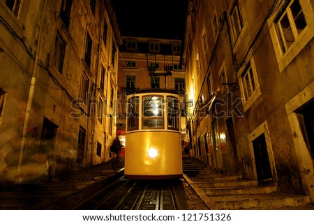 One of the most famous trams of Lisbon (Portugal), photographed at night./ Elevator da Bica. - stock photo