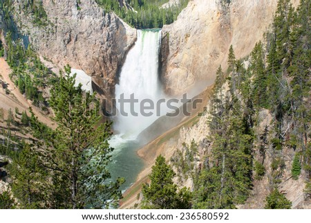 One of the most picturesque falls  in Yellowstone National Park - Lower Falls in the Grand Canyon - stock photo