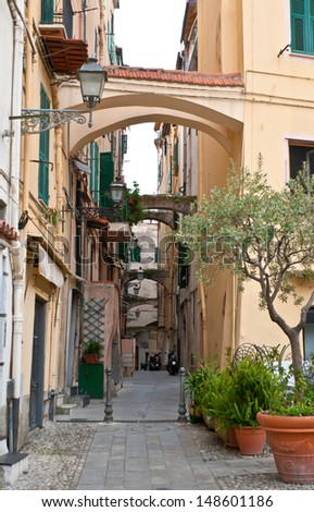 one of the old scenic narrow streets of histiric part of Sanremo, Italy - stock photo
