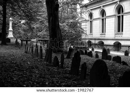 One of the oldest graveyards in america is in boston massachusetts, here is a scene from king's chapel cemetery  black and white - stock photo