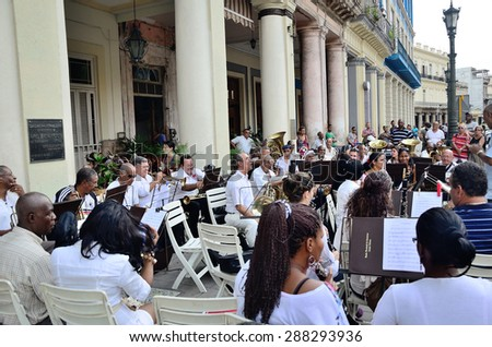One of the regular free performings of the brass band on the streets of Havana, Cuba, on the Central Park square, near hotel Inglaterra on May 10, 2013.    - stock photo