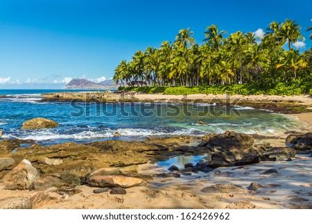 One of the secret beaches near Ko Olina resort on Leeward Oahu, Hawaii - stock photo