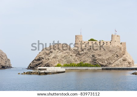 One of the twin forts Jalali and Mirani overlooking and protecting the entrance to the bay where the old palace of Sultan Qaboos bin Said is located. - stock photo