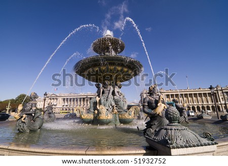 One of the two fountains in Place de la Concorde, Paris France designed by Jacques-Ignace Hittorff - stock photo