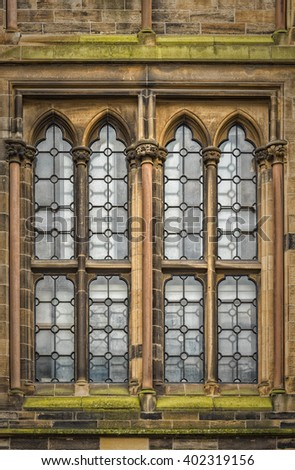 One of the windows on the old main building of Glasgow university in Scotland. - stock photo