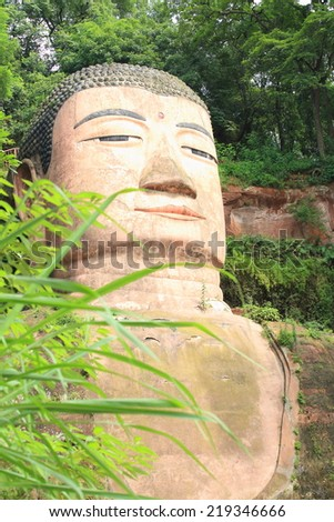 One of the world's largest buddha statue in Leshan, Sichuan, China (it is carved out of mountain and 71 meter tall)  - stock photo