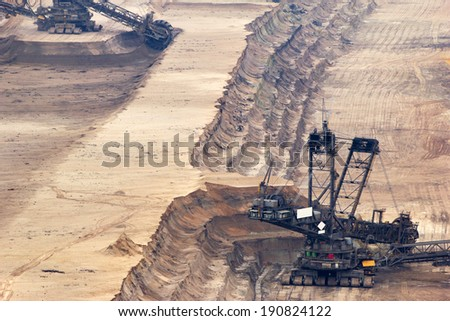 One of the world's largest excavators digging lignite (brown-coal) in one of the world's largest mines  - stock photo