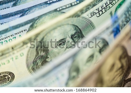 One old type hundred dollar banknote with president's eyes focused - stock photo