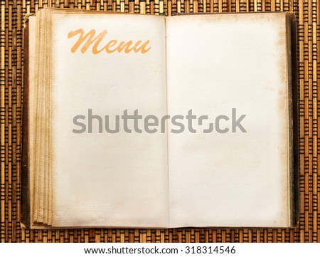 One open blank vintage menu book closeup - stock photo