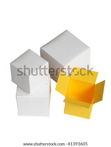 One open yellow paper box near three closed white boxes. Isolated with clipping path
