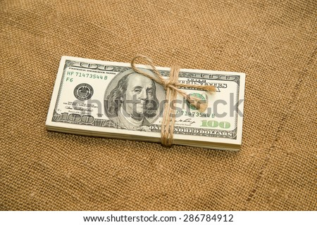 One pack of dollars tied up with rope in the old cloth
