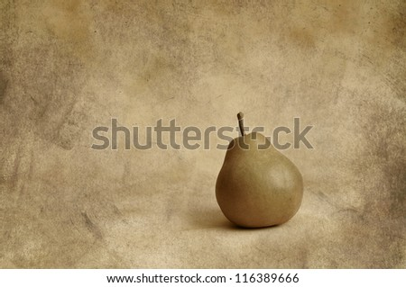 One pear on a grunge background - stock photo