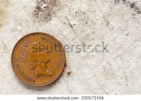 One penny on canvas background with copy - space - stock photo