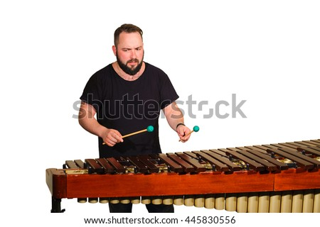 One percussion player isolated on white  play on marimba - stock photo