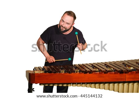 One percussion player on bright wall play on marimba - stock photo