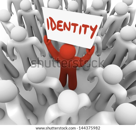 One person holds a sign or banner with the word Identity to spread awareness of his unique brand, quality, integrity or reputation to his audience or customers - stock photo