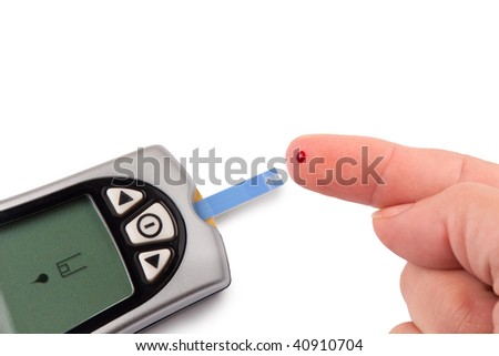 One person with diabetes doing a blood test with a glucometer - stock photo