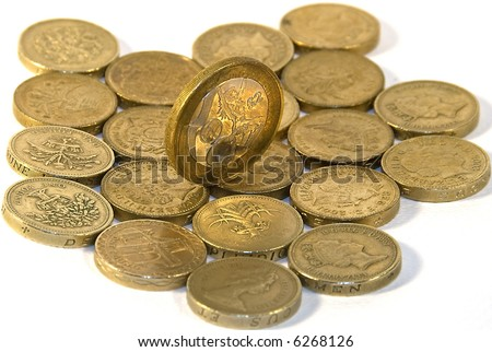 One pound coins over white and 2 pound coin on the top - stock photo