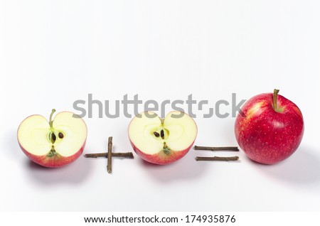 One red apple and two halves. Conceptual photo - stock photo