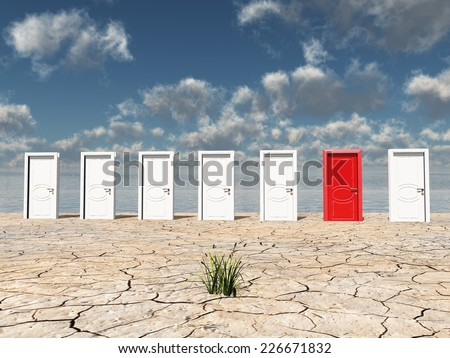 One red door among several in desert with one clump of grass - stock photo