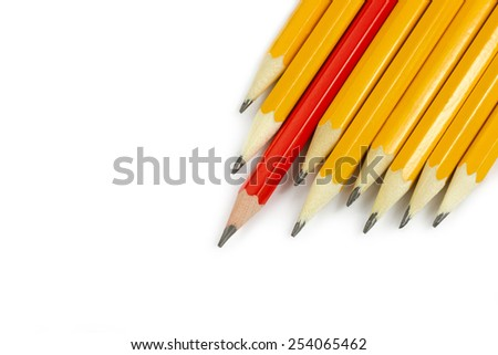 One red pencil standing out from the row of yellow pencils isolated on white background - stock photo